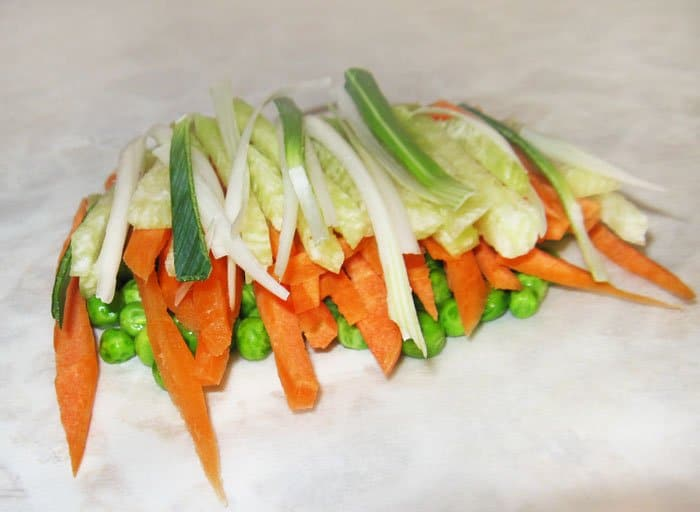 Фото рецепта - Семга, запеченная в духовке с овощами и апельсином - шаг 3