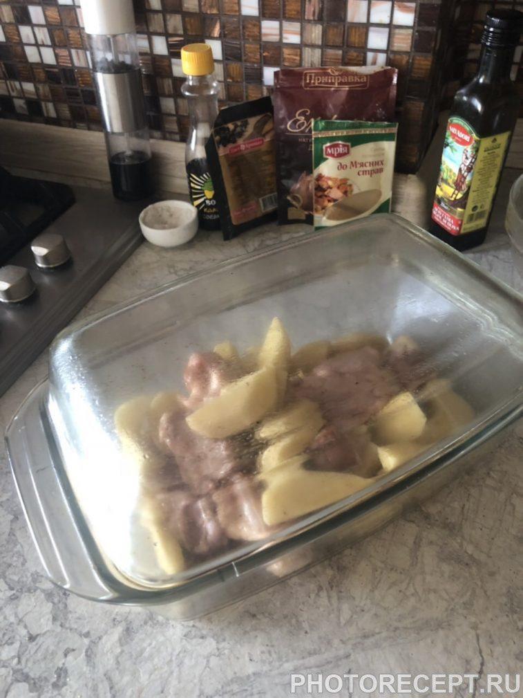 Фото рецепта - Сочные куриные крылышки с картофелем в духовке - шаг 7