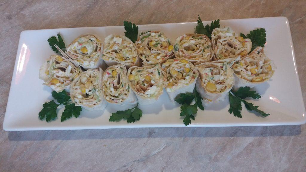 Фото рецепта - Рулетики из лаваша с крабовым салатом - шаг 9