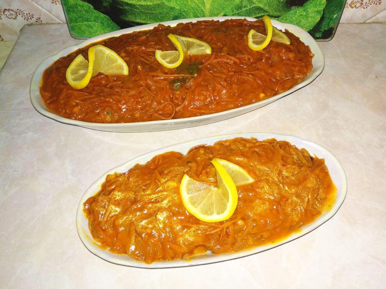 Хек под овощами (лук и морковь)