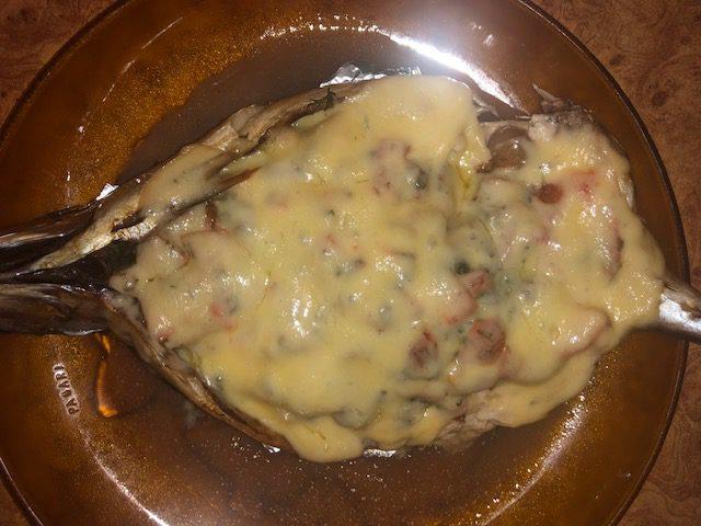 Фото рецепта - Фаршированная скумбрия, запеченная в фольге в духовке - шаг 8