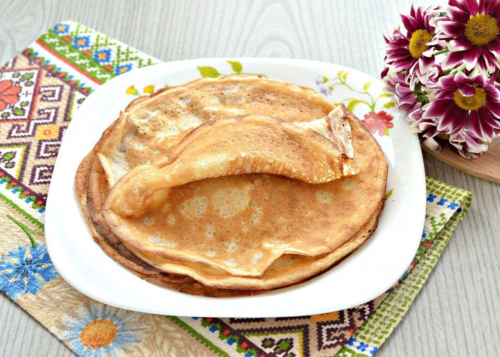 Фото рецепта - Тонкие блинчики на йогурте - шаг 7