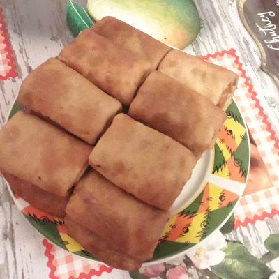 Фото рецепта - Фаршированные блинчики с колбаской и сыром - шаг 7