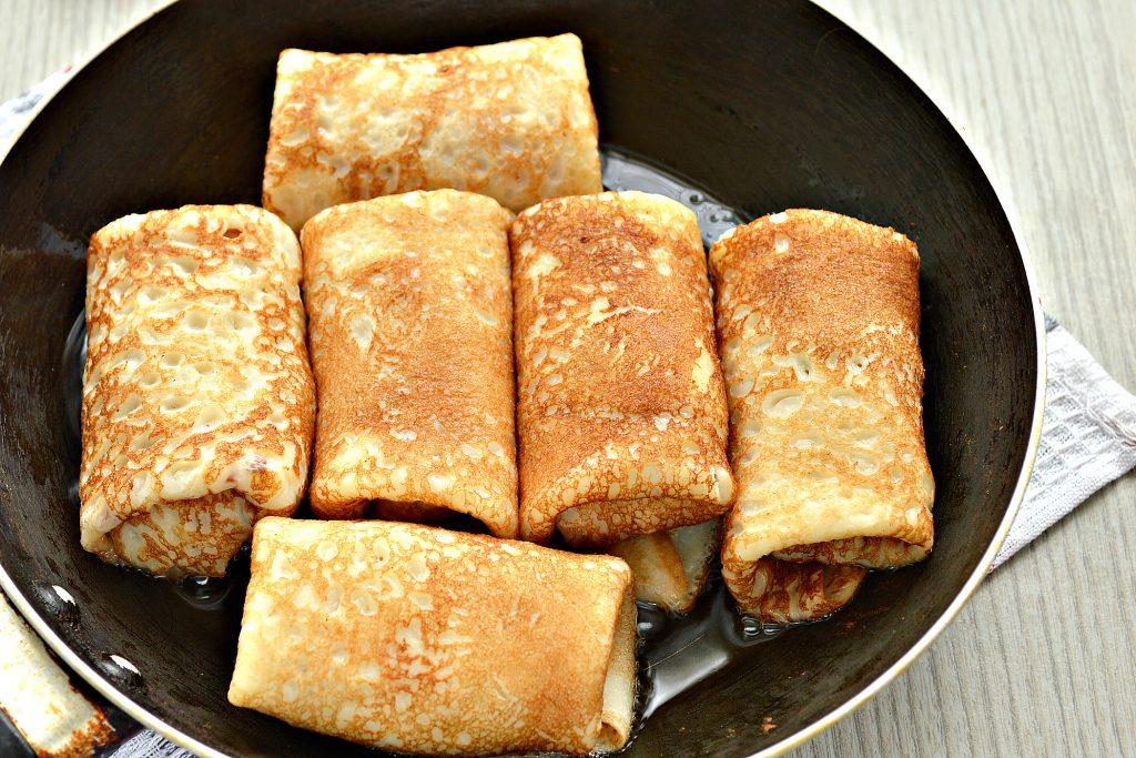 Фото рецепта - Блинчики, фаршированные сыром и курицей - шаг 7