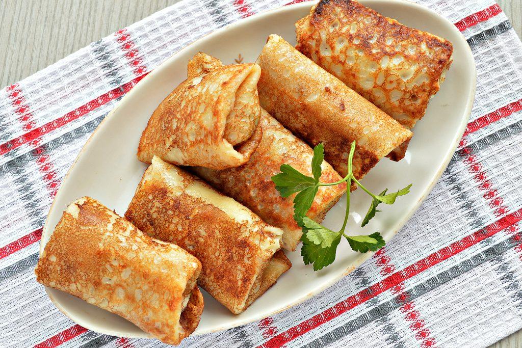 Фото рецепта - Блинчики, фаршированные сыром и курицей - шаг 8