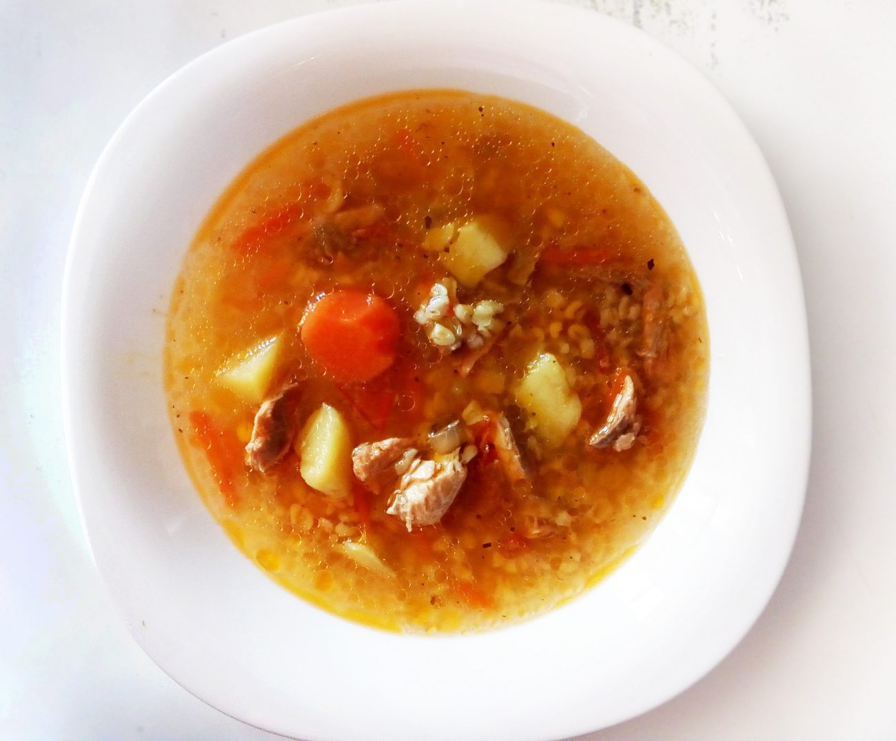Томатный рыбный суп с булгуром