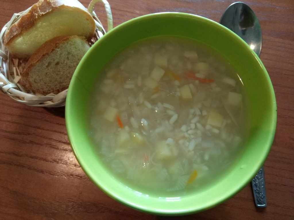 Фото рецепта - Суп из квашеной капусты и риса - шаг 5