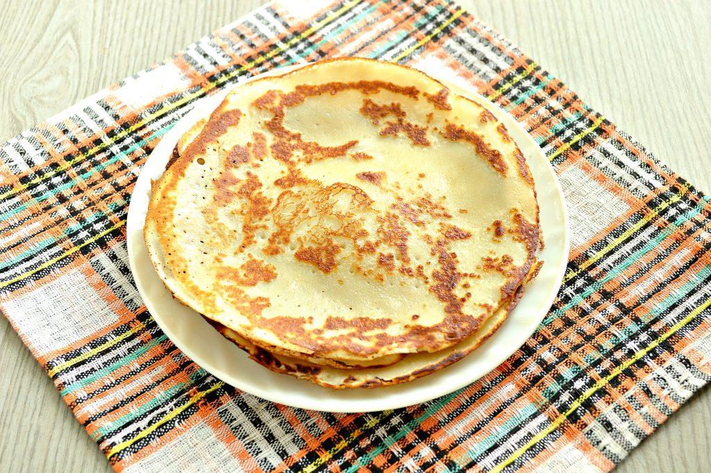 Фото рецепта - Блинчики без яиц на молоке (с крахмалом) - шаг 6
