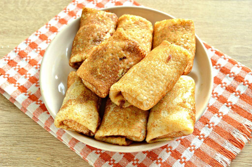 Фото рецепта - Фаршированные блины, запеченные в духовке с копченой колбасой и сыром - шаг 6
