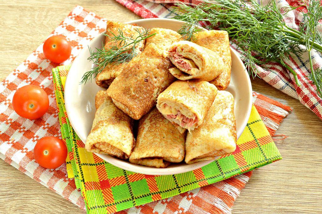 Фото рецепта - Фаршированные блины, запеченные в духовке с копченой колбасой и сыром - шаг 7