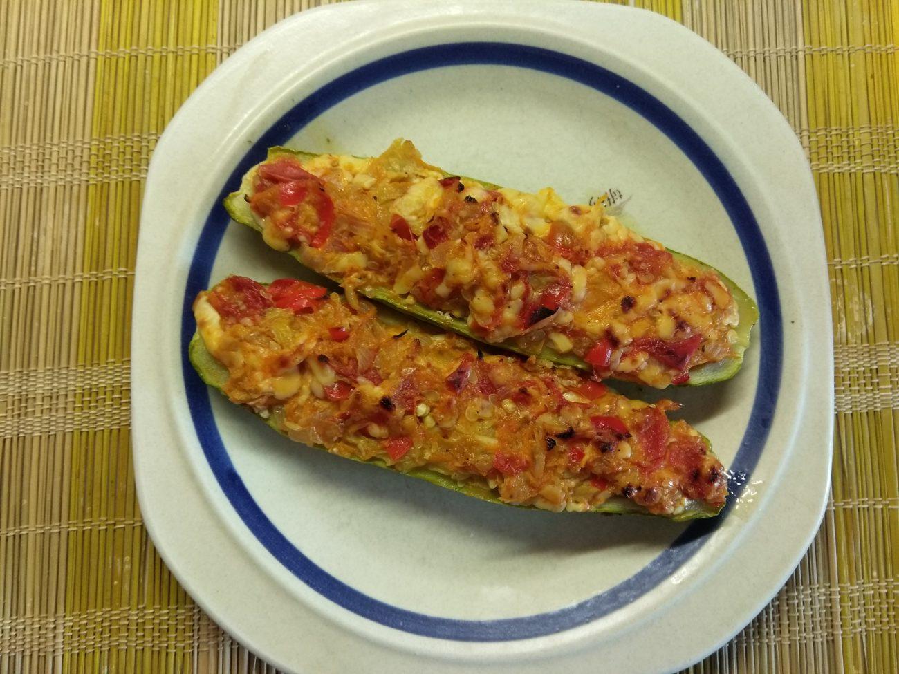 Запеченные кабачки, фаршированные помидорами и сыром