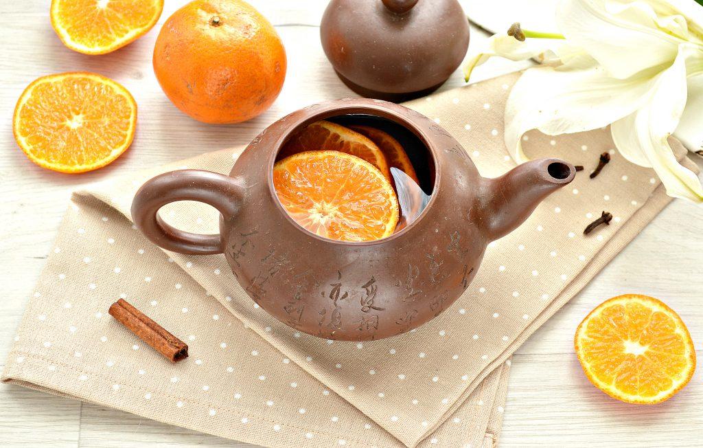 Фото рецепта - Мандариновый напиток с гвоздикой и корицей - шаг 6