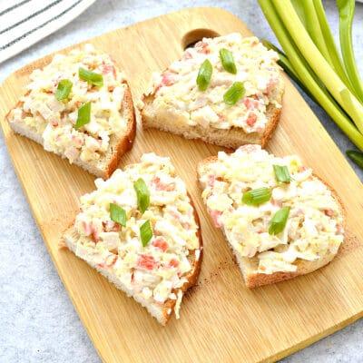 Закусочные бутерброды с крабовыми палочками и сыром - рецепт с фото