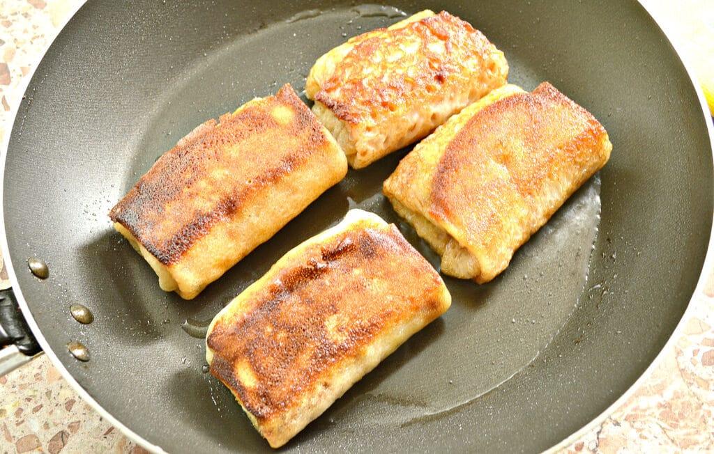 Фото рецепта - Блины, фаршированные тушеной молодой капустой - шаг 8