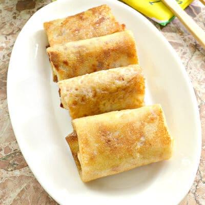 Блины, фаршированные тушеной молодой капустой - рецепт с фото