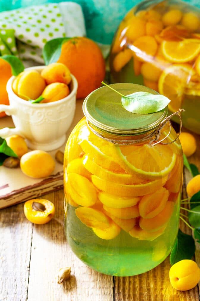 Фото рецепта - Компот из абрикосов и апельсинов на зиму - шаг 5