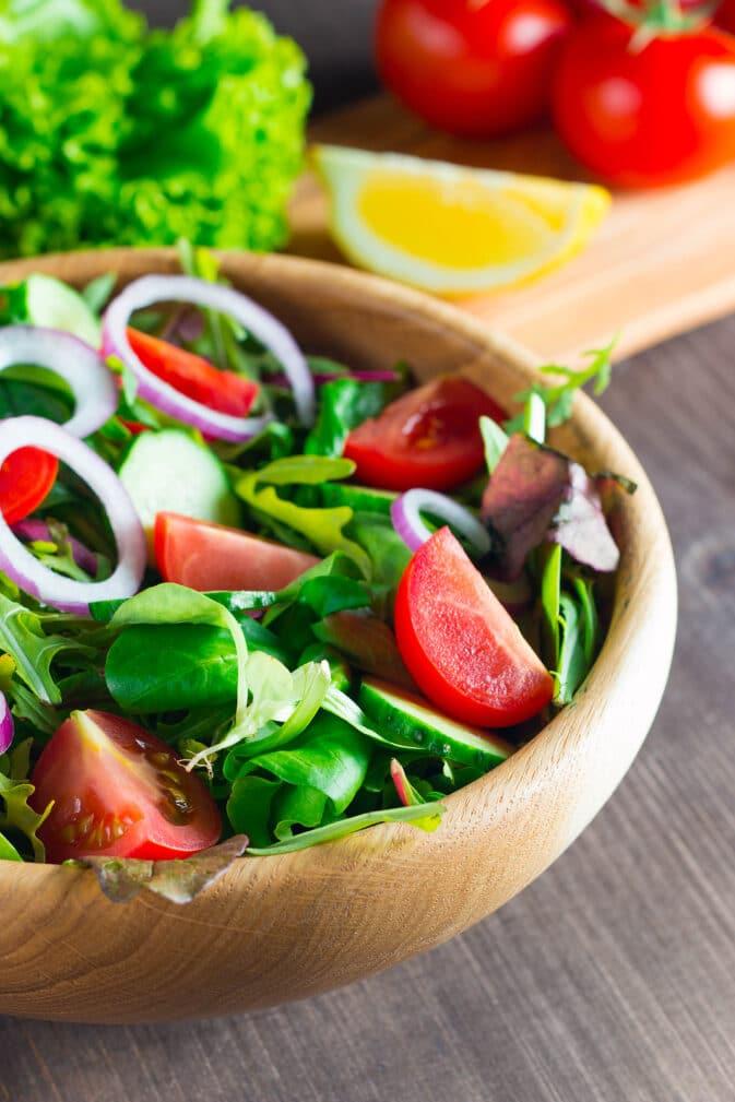 Фото рецепта - Летний салат с помидорами и огурцами - шаг 10