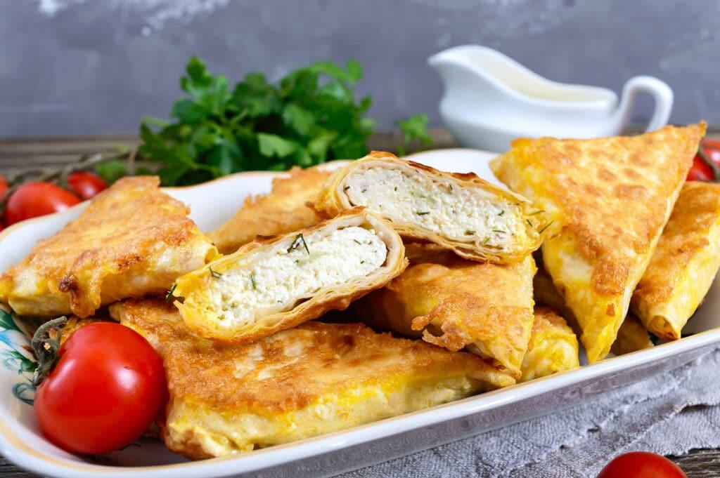 Фото рецепта - Жареные пирожки из лаваша с мясом - шаг 8
