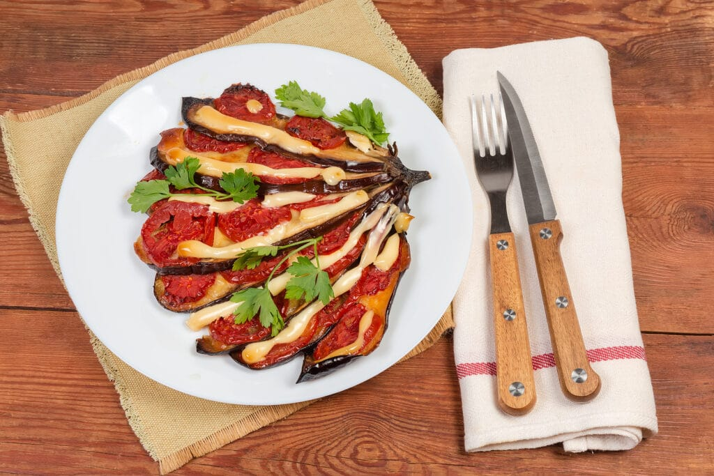 Фото рецепта - Баклажаны с сыром и помидорами - шаг 8