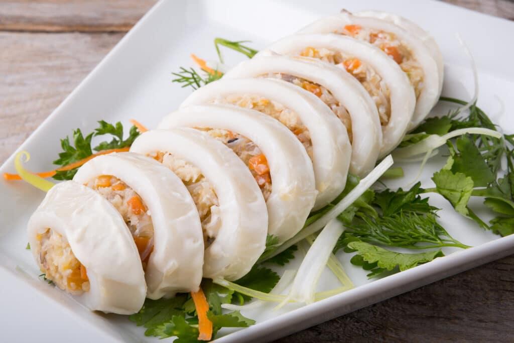 Фото рецепта - Фаршированные кальмары в сметане - шаг 5