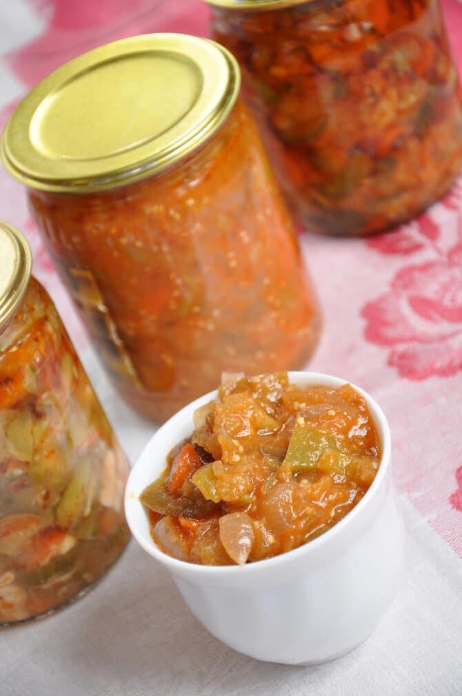 Фото рецепта - Салат на зиму из огурцов, помидоров и перца - шаг 12