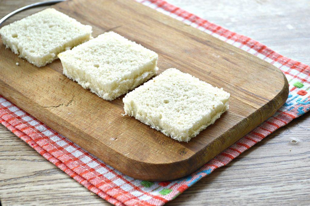 Фото рецепта - Бутерброды с яйцом и сельдью - шаг 4