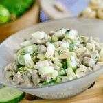 Мясной салат с огурцами, шампиньонами и яичком