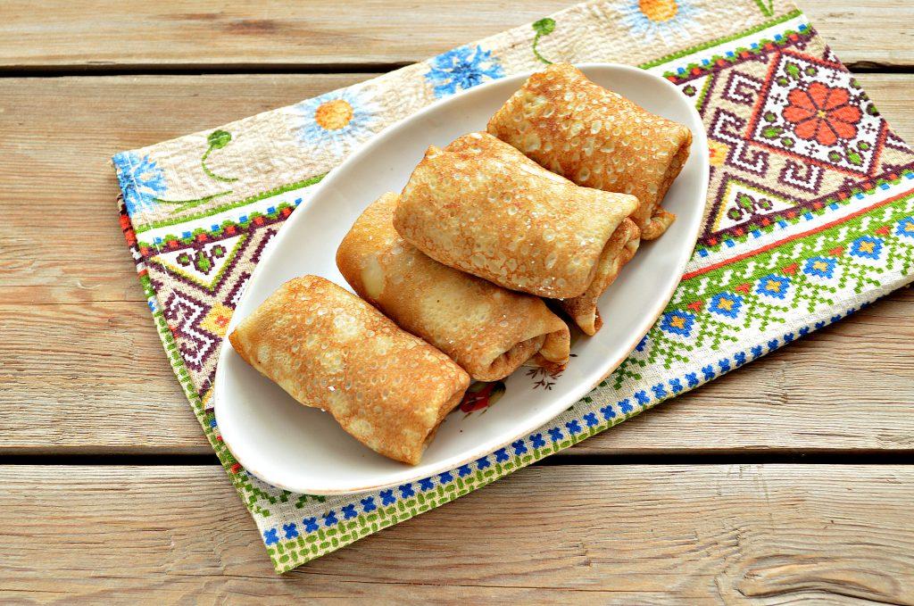 Фото рецепта - Домашние жареные  блинчики с творогом - шаг 5