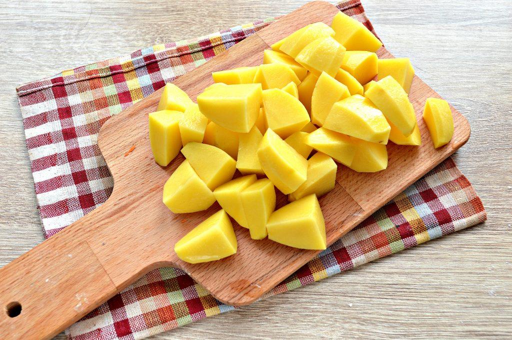 Фото рецепта - Свинина, тушенная с картофелем в кастрюле - шаг 4